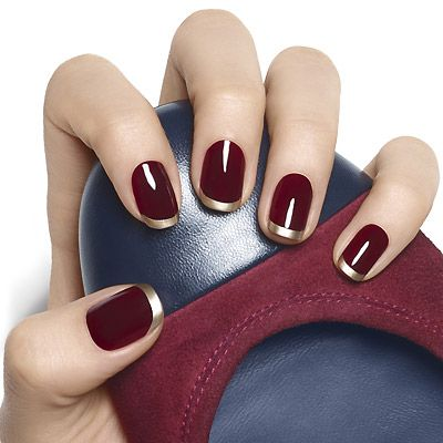 gilt tip by essie -  step 1: hydrate with apricot cuticle oil. step 2: clean then prep nail with an essie base coat or treatment.  step 3: apply 2 coats of berry naughty. let dry.  step 4: using good as gold at the nail tip, sweep on a horizontal arc from left side to center. repeat from opposite side to create a french tip. let dry.  step 5: shine + seal with an essie top coat.