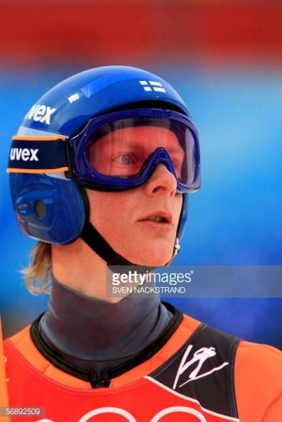 Tami Kiuru of Finland looks at the results board during the 2006 Winter Olympics' long hill team ski jumping trial round in Pragelato 20 February...