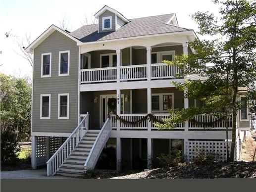 This Coastal House Plan Features 4 Bedrooms 3 5 Baths Vaulted Great Room Wraparound Porches