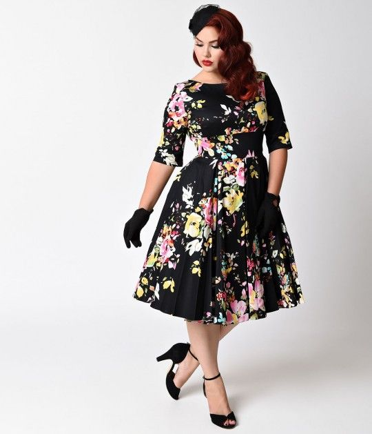 Made for a fabulous frolic! The Plus Size Vintage Hepburn dress has arrived fresh from The Pretty Dress Company in a gorgeous black and signature floral Seville print, cast in a classic plus size retro dress design! Darling details include a chic high boa