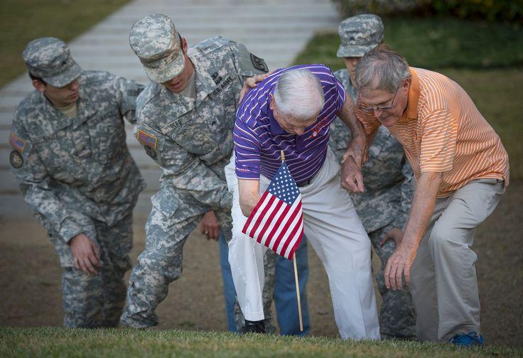 https://flic.kr/p/NRUxMC | Ben Skardon gets help placing a flag | Retired U.S. Army Col. Ben Skardon, 99, a survivor of the Bataan Death March, gets help placing a flag on Otis Morganâs stone on Clemson Universityâs Scroll of Honor, Nov. 3. 2016. Morgan was a fellow Clemson alum who helped save Skardonâs life while they were both interred in a Japanese prisoner of war camp. Morgan did not survive the war. (Photo by Ken Scar)