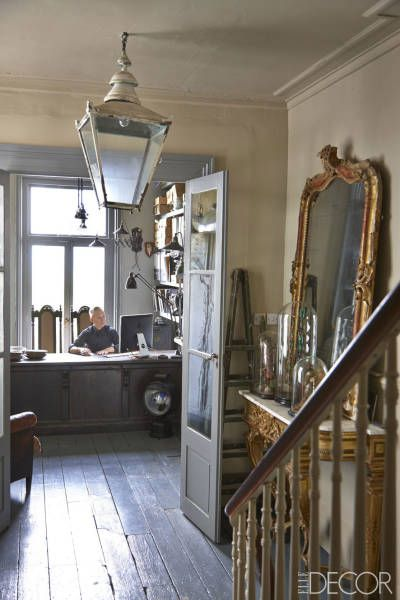 Brighton England Antique Townhome - Seaside English Home - ELLE DECOR A circa-1900 lantern and 19th-century gilt mirror in the study; the walls are painted in Farrow & Ball's Stony Ground.