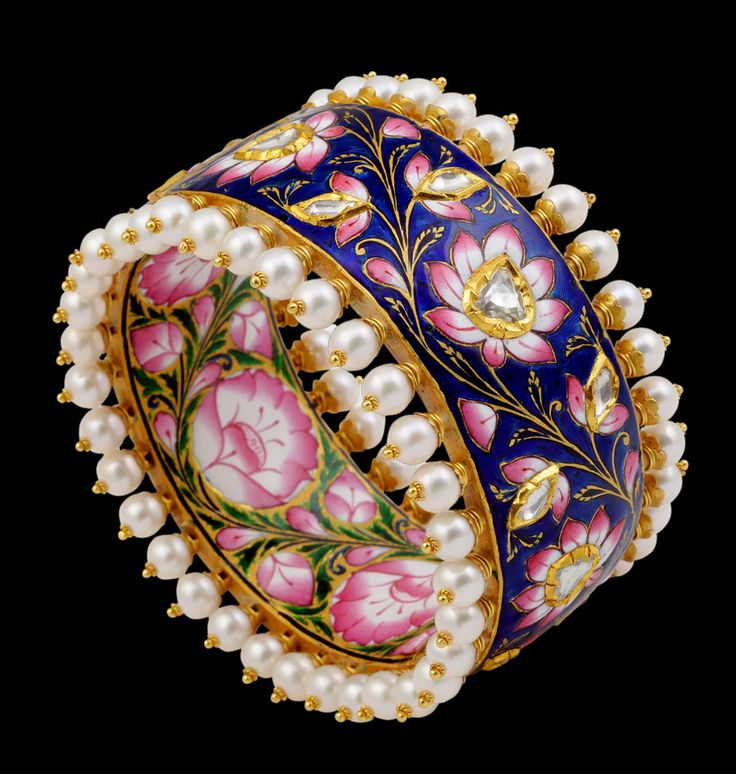 Sunita Shekhawats blue and pink enamel bangle with lotus flowers. Note how it is decorated both inside and out.