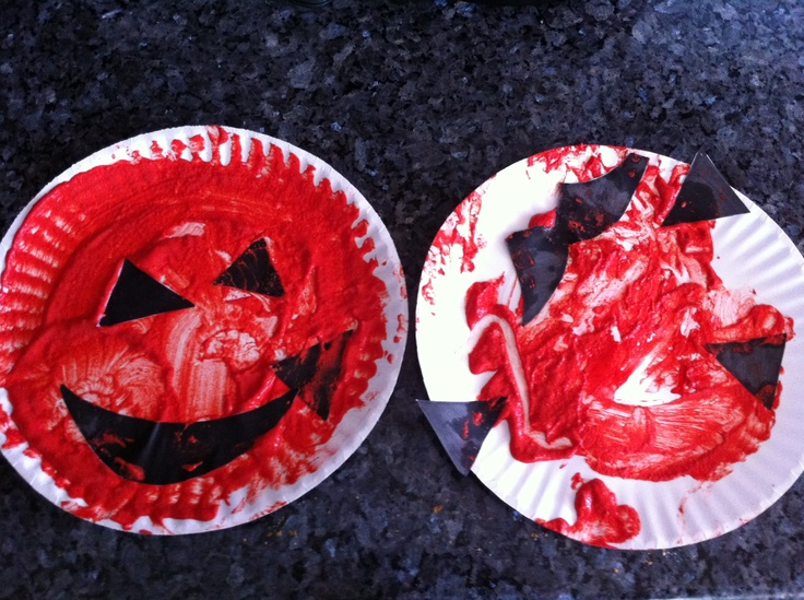 Quick & Easy infant / toddler pumpkin art. This changes up the typical paper plate pumpkin by allowing children to explore their senses. I used red paint and mustard to create a chunky texture as well as allow children to use their sense of smell (ketchup and mustard for younger children). The project also challenges children's body and spatial awareness. For the face a just cut it out of black paper. My 2 year old did the pumpkin on the left and my 1 year old the one on the right.  Have…