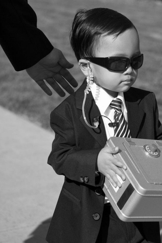 Ring Security instead of ring bearer. hahaha! so cute!/••••This is simply HILARIOUS!!!!  Whoever planted the seed in this kid's ear about his responsibility did an excellent job.  He was delivering his box or he was going to take someone out!!!