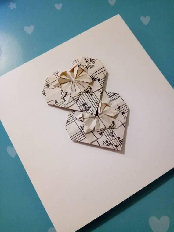 Hand made origami card-left blank for your message. Perfect for many different occasions! This card features two origami hearts folded from the pages of vintage sheet music. This makes the card perfect for a sheet music lover! The card itself is cream in colour and is a high