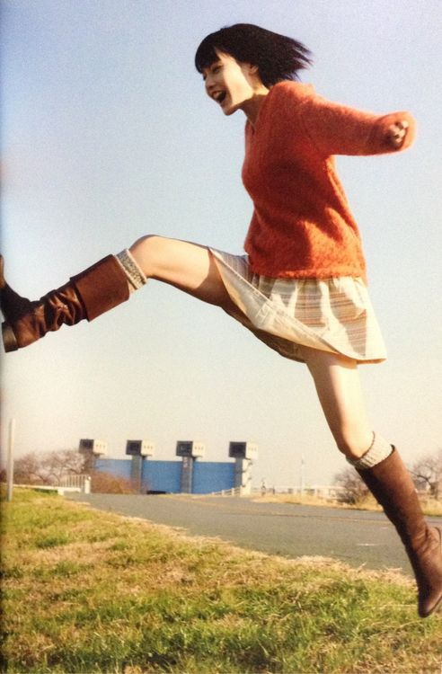girl leaps over building
