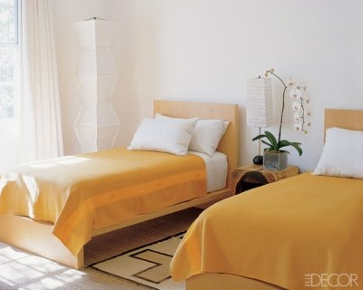 Kelly Klein's Florida retreat~Saffron-yellow blankets by Hermès, snow-white bed linens by Calvin Klein Home. Noguchi paper lamps.