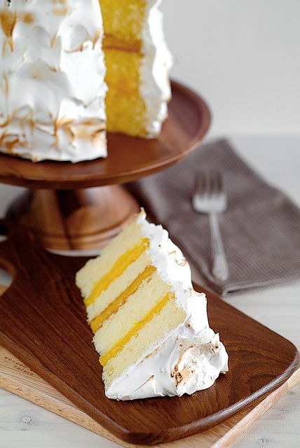 lemon layer cake with lemon curd and meringue frosting