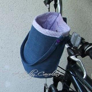 Denim bag for bike. See tutorial here:      http://www.noodle-head.com/2010/06/bicycle-bucket-tutorial.html