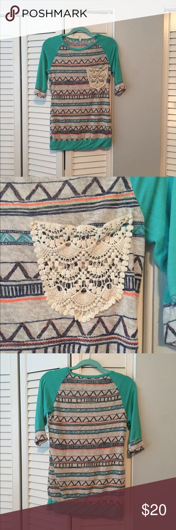 1/2 sleeve Aztec shirt Very lightweight soft material. Crochet pocket on front of blouse. Tops Blouses