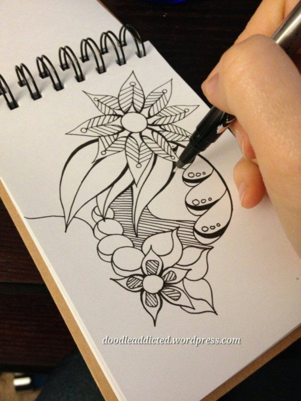progress pics of doodling in a smaller sketchbook with sharpies; I love all of the doodles on this blog!