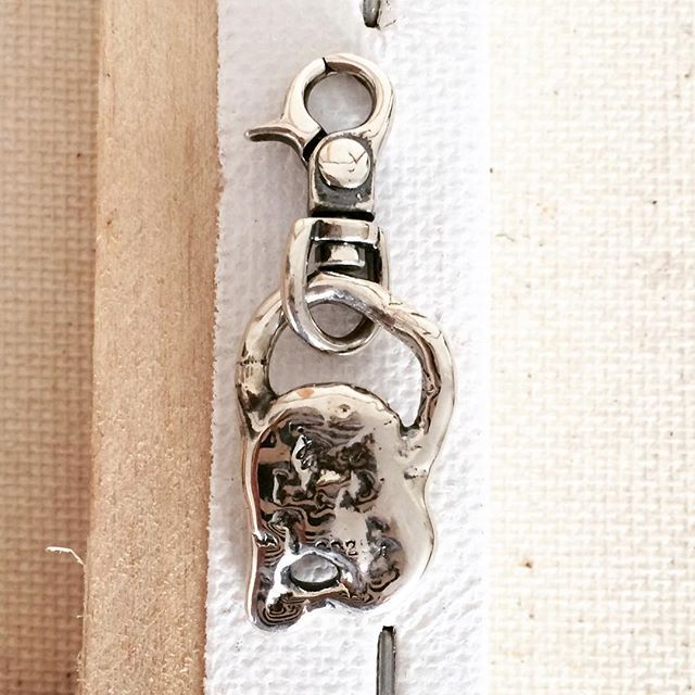 Purse click on pendant. Sterling silver. Great way to add some edge to a boring string of pearls!