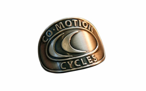 Co-Motion Cycles identity as a nickel headtube badge for the bikes