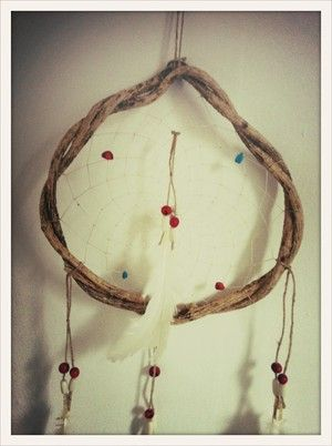 Light Feather Hand made South American dream catcher. Keeps the bad dreams at the door.