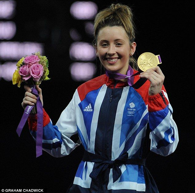 Taekwondo fighter Jade Jones shows off her gold medal - the 25th won by Team GB at London 2012