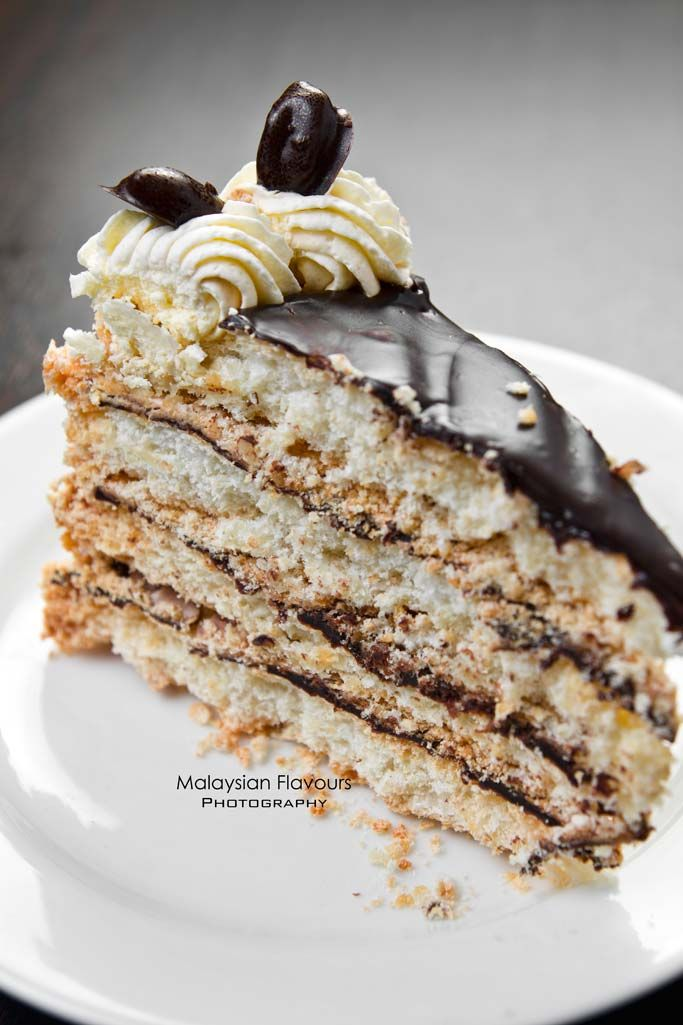 Japonaise Cake from Suchan. Having almond meringue layers with chocolate ganache and fresh whipped cream, lending a spongy and crispy concoction. #suchan #cake #dessert #chocolate