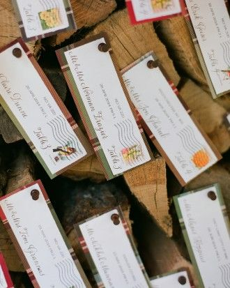 GREAT IDEA!  --Guests found the RSVP envelopes they returned to the bride and groom pinned to the woodpile in front of the cabin with their names and table numbers penned on them. Red-and-green plaid backed the revamped envelopes and made for a more durable finish.
