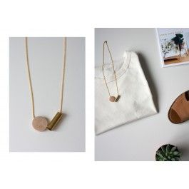 The necklace is designed by iris. iris is one part of the art collective THINGS LIKE DIAMONDS.The bead hangs on a 50cm brass curb chain with a lobster clasp. The circle bead is made of wood with a matte varnish, the tube is made of brass.Due to the handmade nature of each bead and online screen colors - size, shape and color may vary slightly to what you see here.