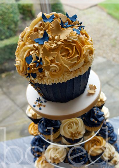 golden wedding cake with cupcakes gold blue cupcake tower wedding search faith s 14779