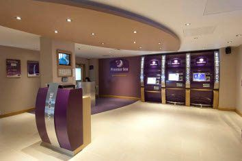 Premier Inn check-in desks. Minimal and space saving\ space creating