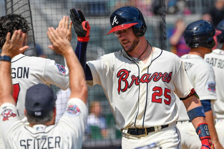 Aug 20, 2017; Atlanta, GA, USA; Atlanta Braves catcher Tyler Flowers (25) shakes hands at the dugout after hitting a grand slam home run against the Cincinnati Reds during the fifth inning at SunTrust Park. Mandatory Credit: Dale Zanine-USA TODAY Sports