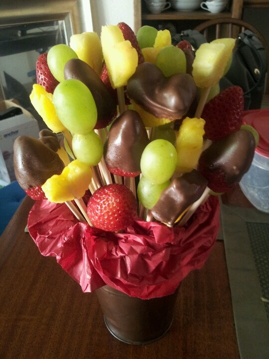 "DIY  fruit bouquet/""edible arrangement."" Grapes, Pineapple and Strawberry. Cookie cutters and dipped in chocolate. Easy! Good alternative for the typical floral bouquet. Perfect for mother's day, father's day, birthdays, valentines day, and other holiday gifts!"