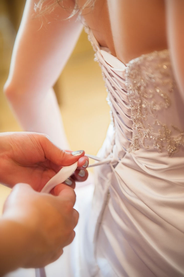 Mrs. Coyote's corset dress took quite some time to tie up. Make sure to add some extra time into your wedding day timeline if you have a corset dress! Photo by Upstate Photographers.