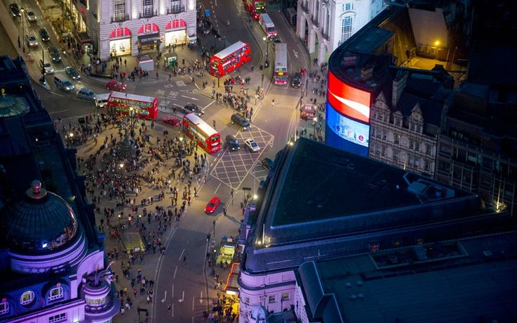 London's Piccadilly Circus at night  Picture: Jason Hawkes / Barcroft Media