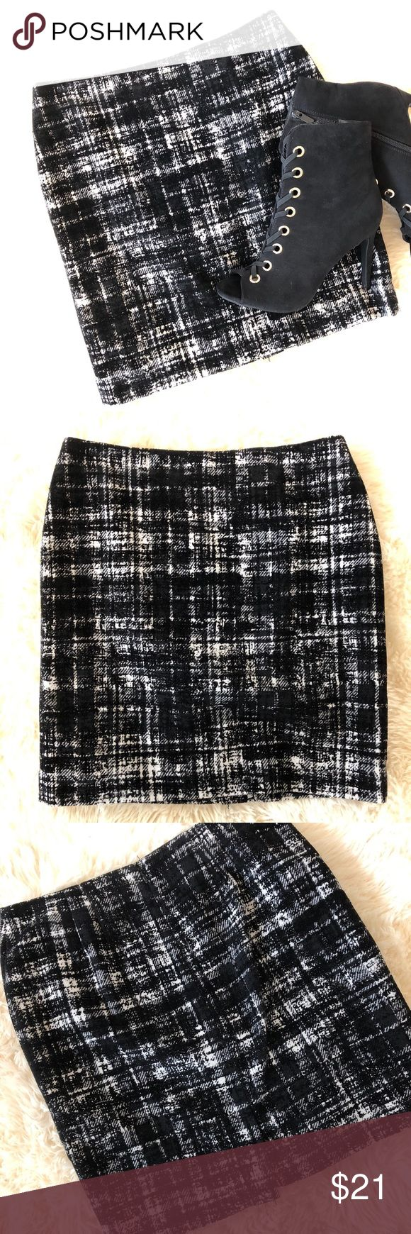 Ann Taylor Petite black white modern plaid skirt. Beautiful Ann Taylor petite black and white plaid skirt. Size 2P. EUC no rips tears or stains. Modern plaid design with a but if velvet flocking in places. 42% polyester 22% wool 22% acrylic. Fully lined zip back and back kick pleat. Elevate your work look with the skirt paired with a bright colored top. Ann Taylor Skirts