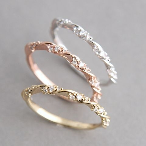 Dainty wedding band that round go underneath a beautifully simple round cut enagement ring!