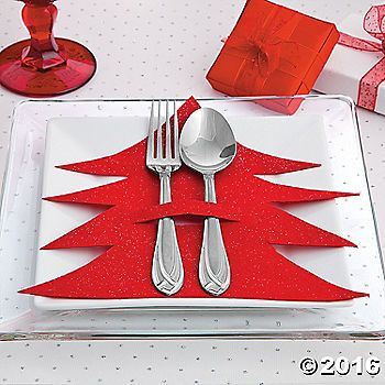 Dress up your Christmas table decorations with this easy Christmas craft. Take each table setting from bah-humbug to Ho Ho Ho Happy!1. Fold a piece of felt in ...