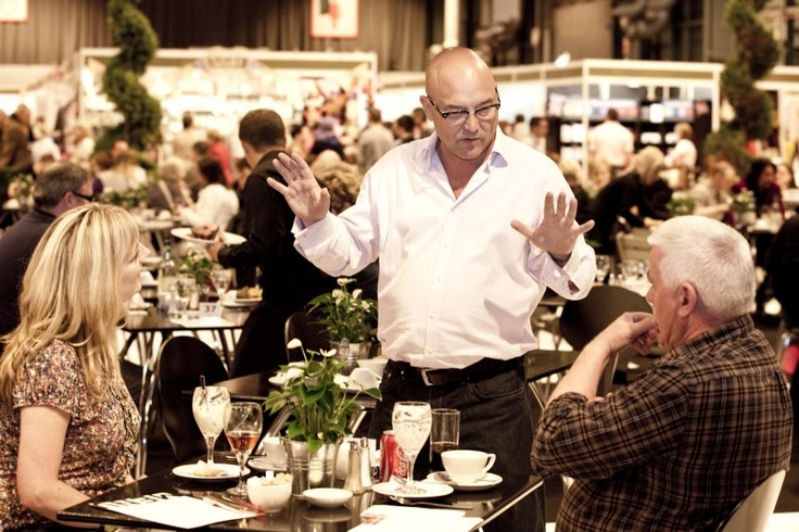 Masterchef's Gregg Wallace chatting with some diners.