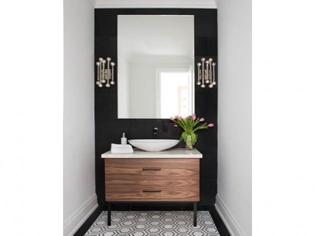 Try a bold black accent wall paired with a black and white floor tile. The black wall pairs well with the black in the tile and adds a nice contrast next to the white walls around it. It is important that if you have a black accent wall that it ties in with some other element in the room and that it is tied in with the flooring of the space. Jodie Rosen Design- Caesarstone Frosty Carrina countertop