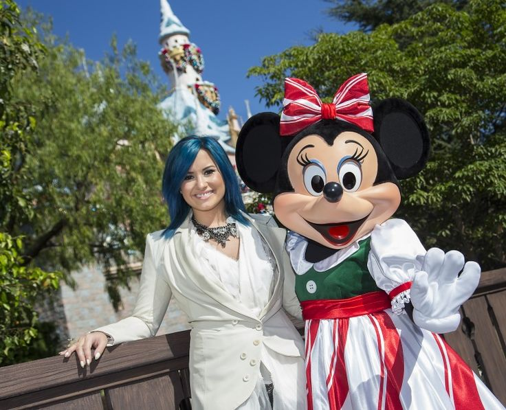 Disney royalty. Demi Lovato and Minnie Mouse have a magical time at Disneyland on Nov. 9 in Anaheim, Calif.Demilovato, Disney Christmas, Blue Hair, Minnie Mouse, Parks Christmas, Disney Parks, Disneyland, Demi Lovato, Disneyparks