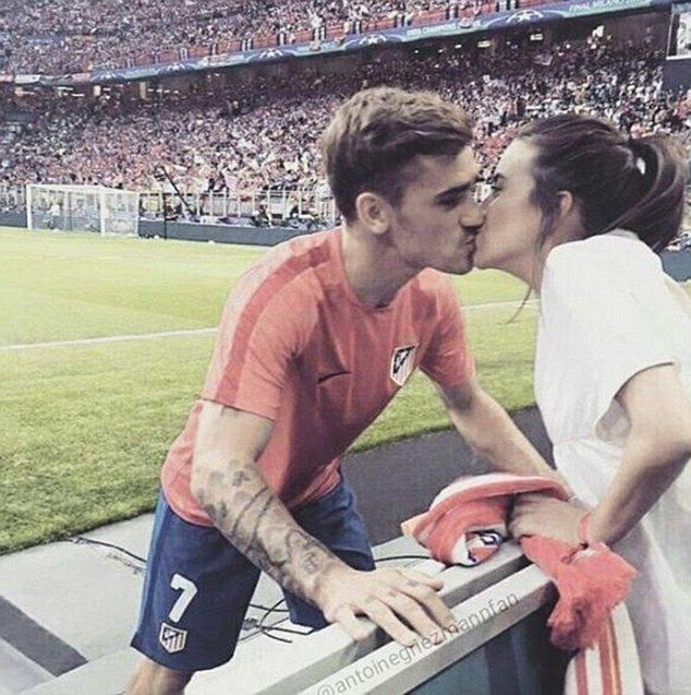 Public: Star player Griezmann managed to take some time out during a match to have a celebratory kiss with his girlfriend Erika