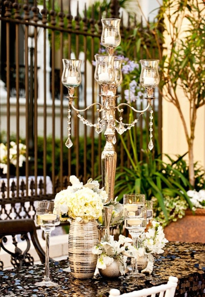 I like this softer gold  Ultra Luxe New Orleans Wedding from Sapphire Events - wedding centerpiece idea