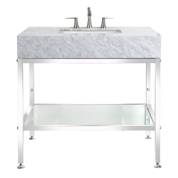 This Marble Slab Vanity Is Placed On Top Of Stainless Steel Legs