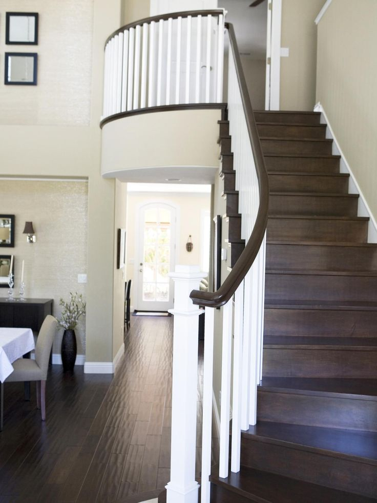 Dark Brown Wood Stairs Compliment The Chocolate Brown Handrail And Pop  Against The White Banisters.