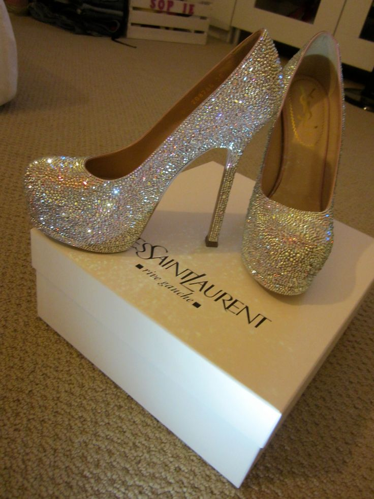 Lovely but even if I had a GAZILLION dollars, not paying $4400 for shoes.Yves Saint Laurent pump with stiletto heel strassed in Aurora Boreale Swarovski crystals. $4,395.00, via Etsy.