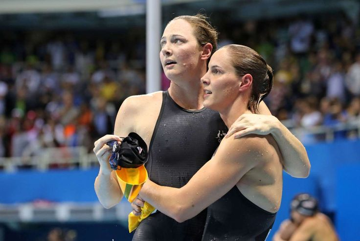 Sister act:   Australia's Cate Campbell, left, and sister Bronte hug after the…