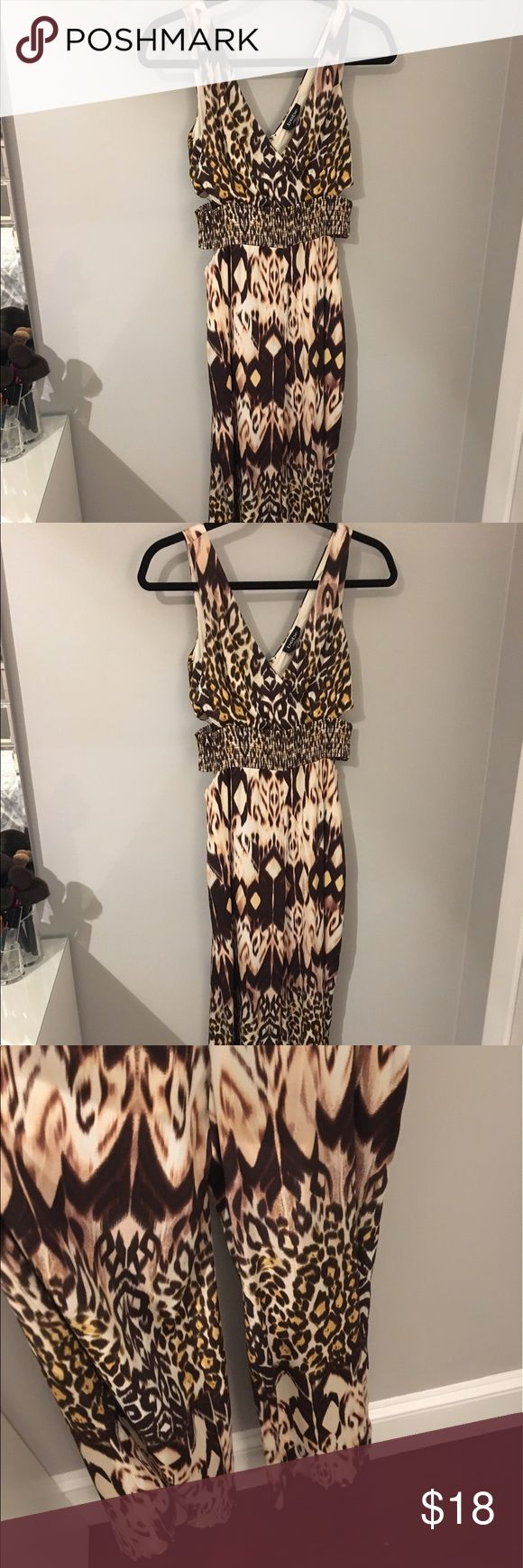 Bebe animal print jumpsuit Fun Bebe jumpsuit that I never wore but still love! It is open on the sides. bebe Pants Jumpsuits & Rompers