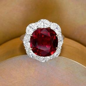 Cushion Thai Ruby Ring Two-tone ring in platinum and 18k yellow gold holds a 10.01 ct. cushion-cut Thai ruby, framed with a halo of oval-shape diamonds. SKU AMG 652 R Brand Bayco MSRP $1,200,000.00