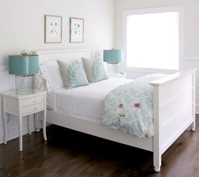 A sweet minimalist bedroom in white with touches of teal.  Really understated and pretty.