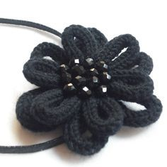 Black flower - this one is knit but I think you could create a crochet cord, form a loop, sew in the center, repeat for the other 5 loops. Repeat for a second layer with larger loops. Finish off. Add a bundle of beads to the center. ✿Teresa Restegui http://www.pinterest.com/teretegui/✿