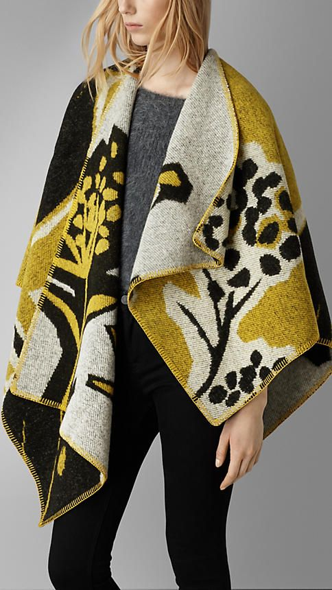 Burberry Willow green Insects of Britain Wool Cashmere Poncho - A wool cashmere poncho crafted in Scotland. The design is jacquard-woven with a vibrant illustrative pattern. Discover the scarves collection at Burberry.com
