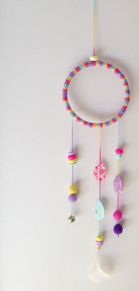 Wall hanging that will look cute in any room or nursery. Hand wrapped 5 inch hoop with a mixture of felt balls, clay beads, fabric drops, a bell, and feathers. Very eye catching and will create a talking point in the room. Made to order. Fabric and beads may differ slightly but will be as close to this picture as possible. Please allow 10-15 business days for your order to be made. Thank you for looking