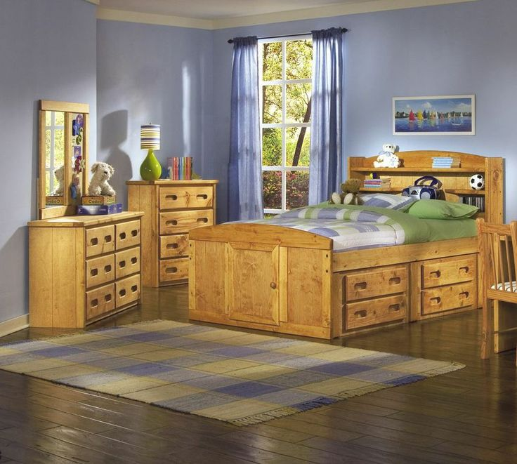 Captains Bedroom Set in Amber Wash by Rustic Classics. Four under-bed storage drawers provide room for clothes, toys and other items. Can include platform twin bed or full bed, dresser, mirror, nightstand, chest, desk & hutch, bookcase and a toybox. #furniture #canada #wholesale #kidsfurniture #bedroomsuite #storagebed