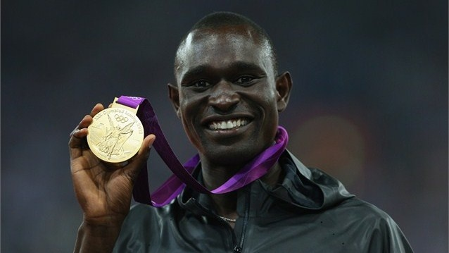 Gold medallist David Lekuta Rudisha of Kenya poses on the podium during the Victory Ceremony for the men's 800m