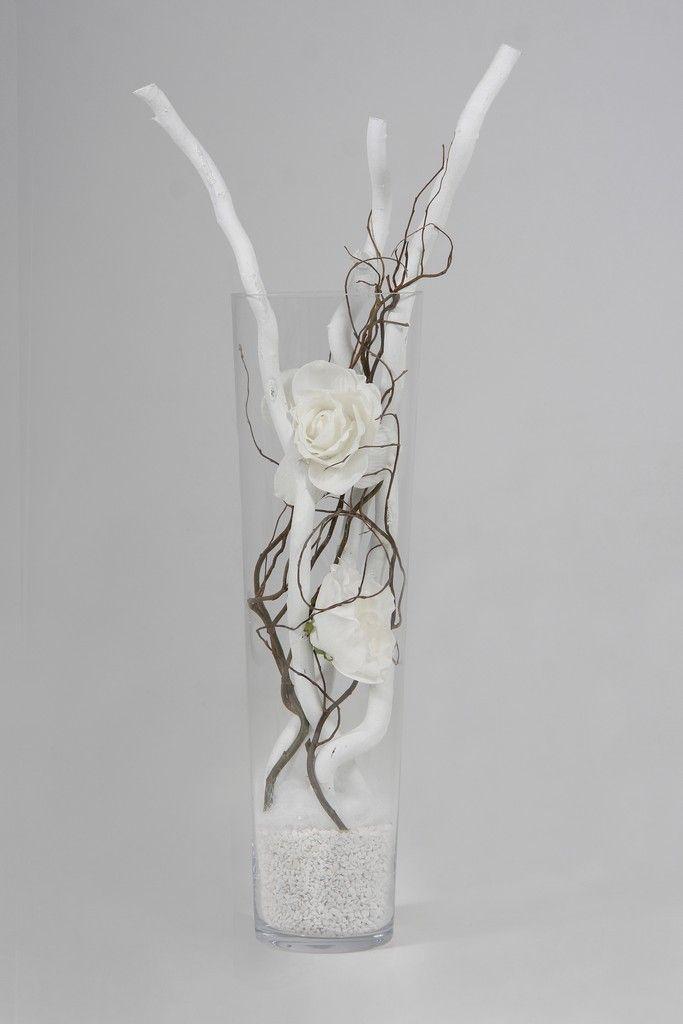 Heb je een lege lange glazen vaas, en je weet niet wat ermee te doen,. Vul hem met witte stammen, witte rozen en naturel decoratietakken, en je heb een mooie vaas, makkelijk in onderhoud. Dit alles verkrijgbaar op webshop decoratietakken. www.decoratietakken.nl